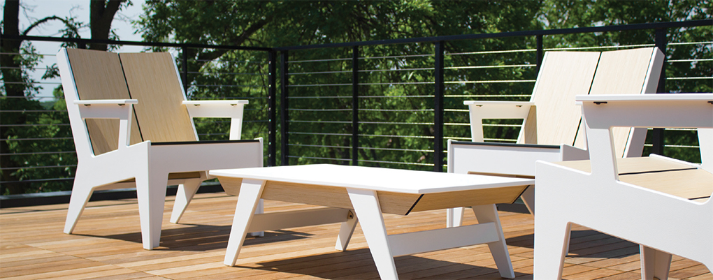 A white coffee table and chairs by 360 Five Designs.