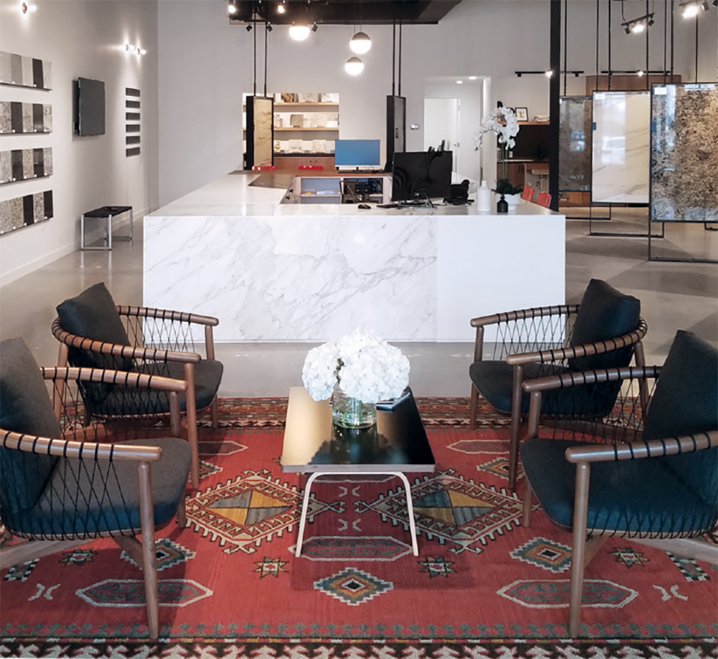A new showroom for Clio Surfaces displaying a table and chairs and marbler countertop.