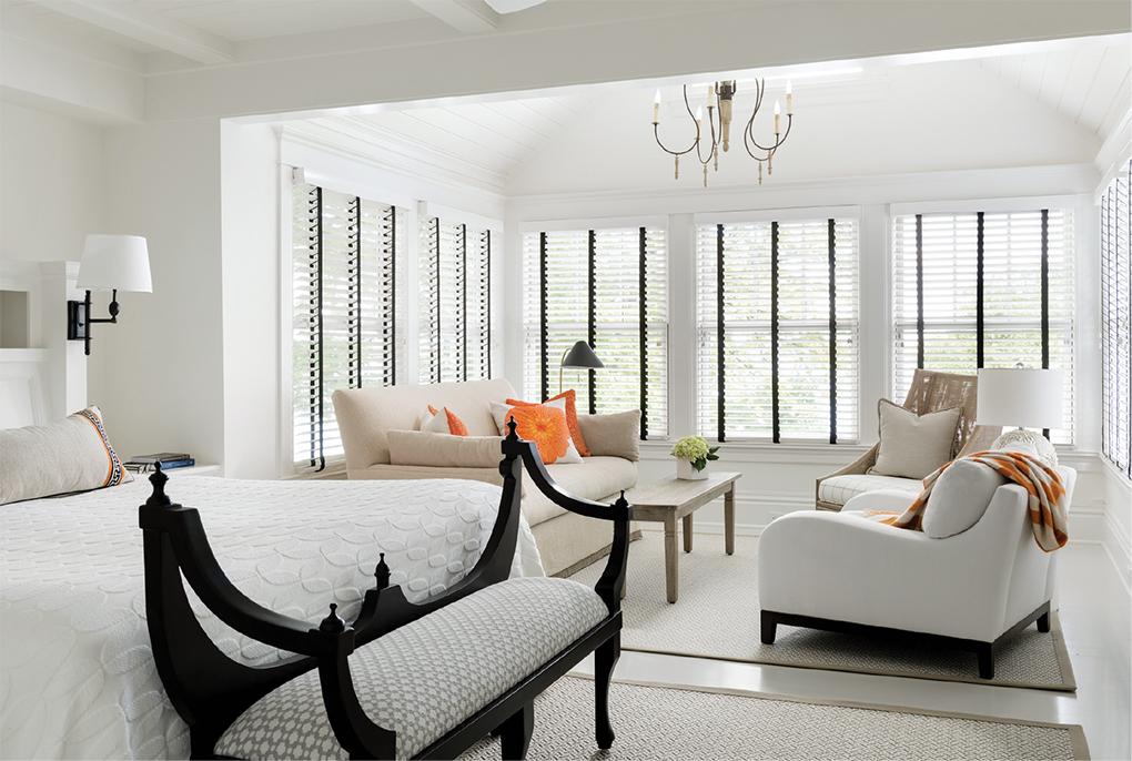 An all white master bedroom overlooks Lake Minnetonka.