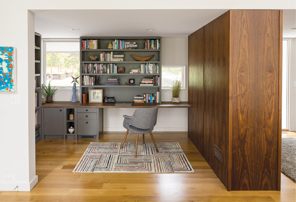 A study with built-in desk and bookcases in a home built by SALA Architects.