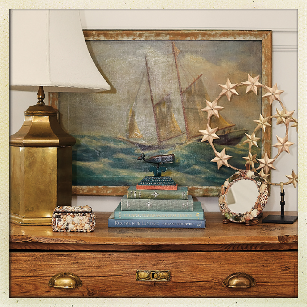 A ship painting resting on a table.