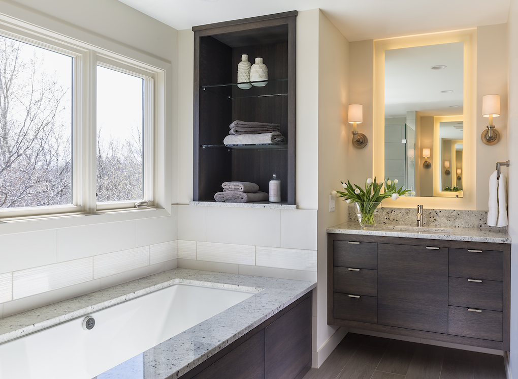 Contemporary bathroom with dark wood vanity and tub surround