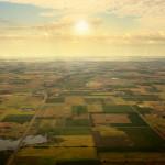 Aerial Sun on the Horizon over Farmland