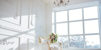Interior of room with white chair and large window