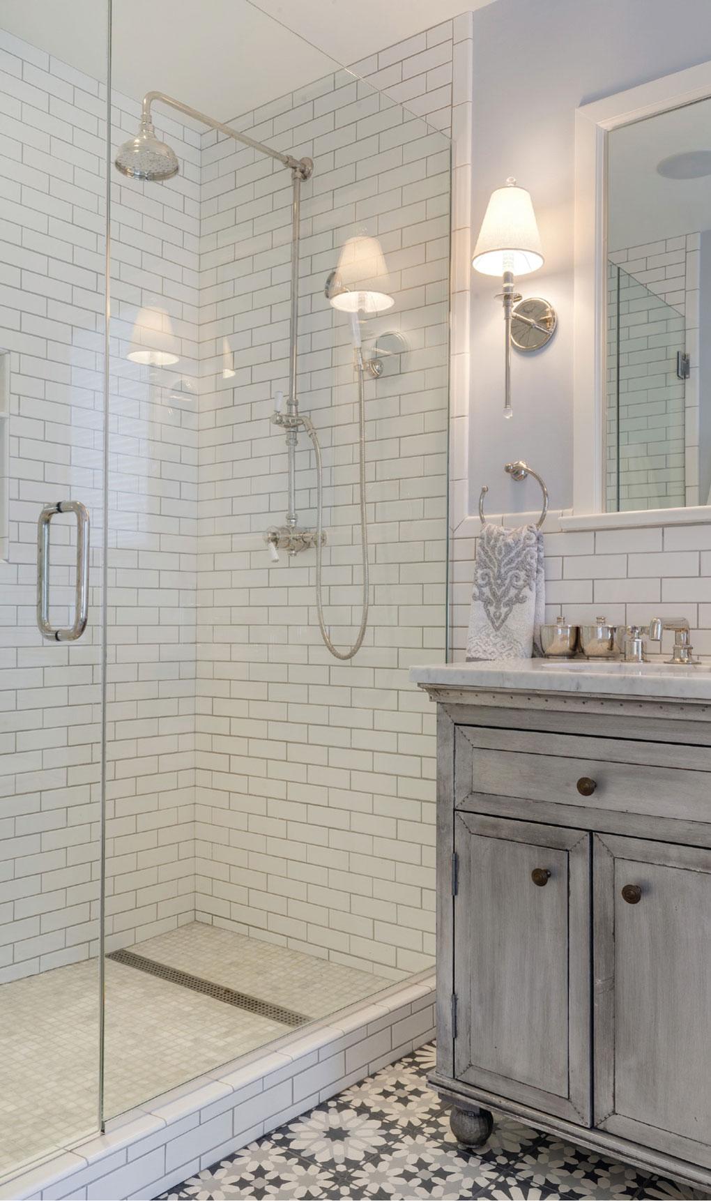 Mast bath features subway tile and Carrara marble