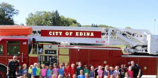 City of Edina residents in front of fire truck