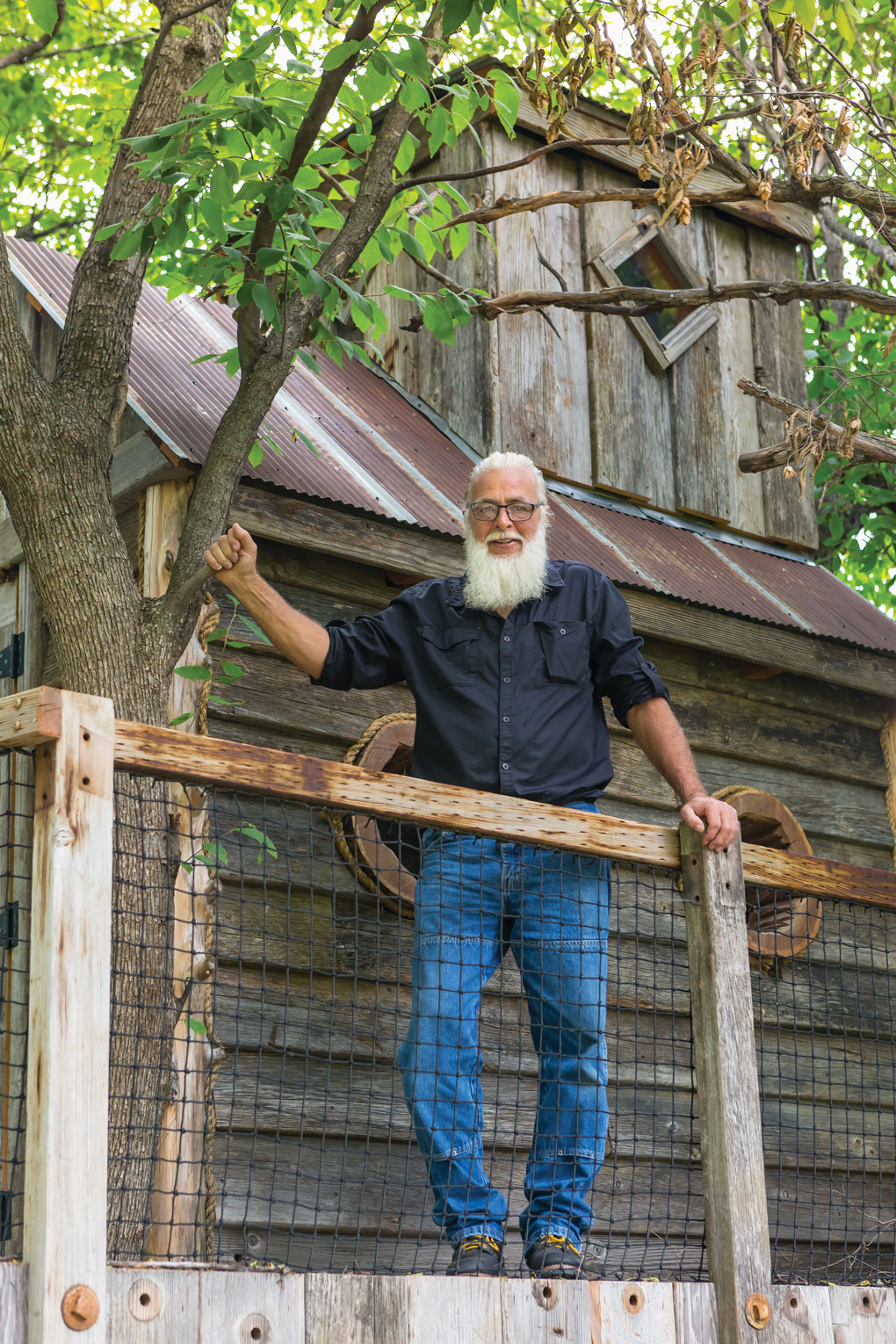 Treehouse and man who built it