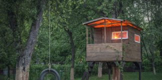 kid friendly treehouse and tire swing