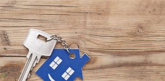 Keys on a wooden background after selling your house.