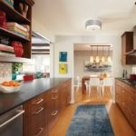A kitchen in Edina designed by Jenn Taft of Engler Studio featured on the 2017 ASID Kitchen Tour that shows dark wood cabinetry and stainless steel appliances.