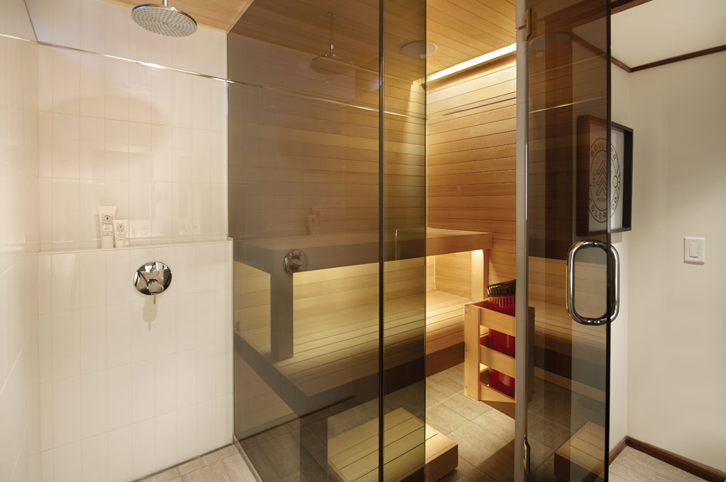 A remodeled bathroom shows a sauna next to the shower.