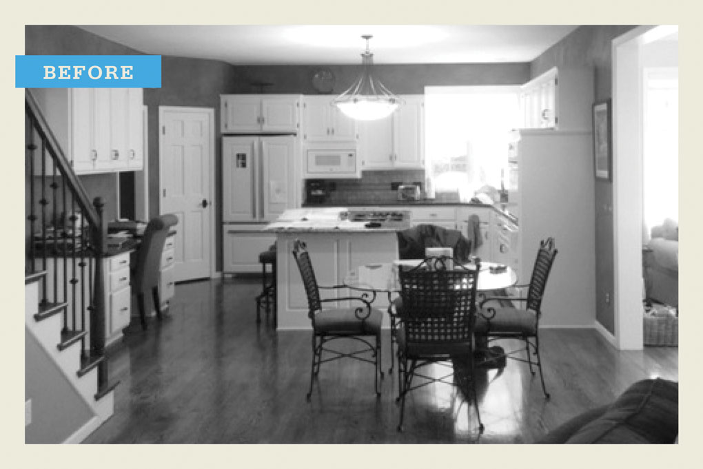 "A black and white ""before"" photo of a kitchen before being remodeled."