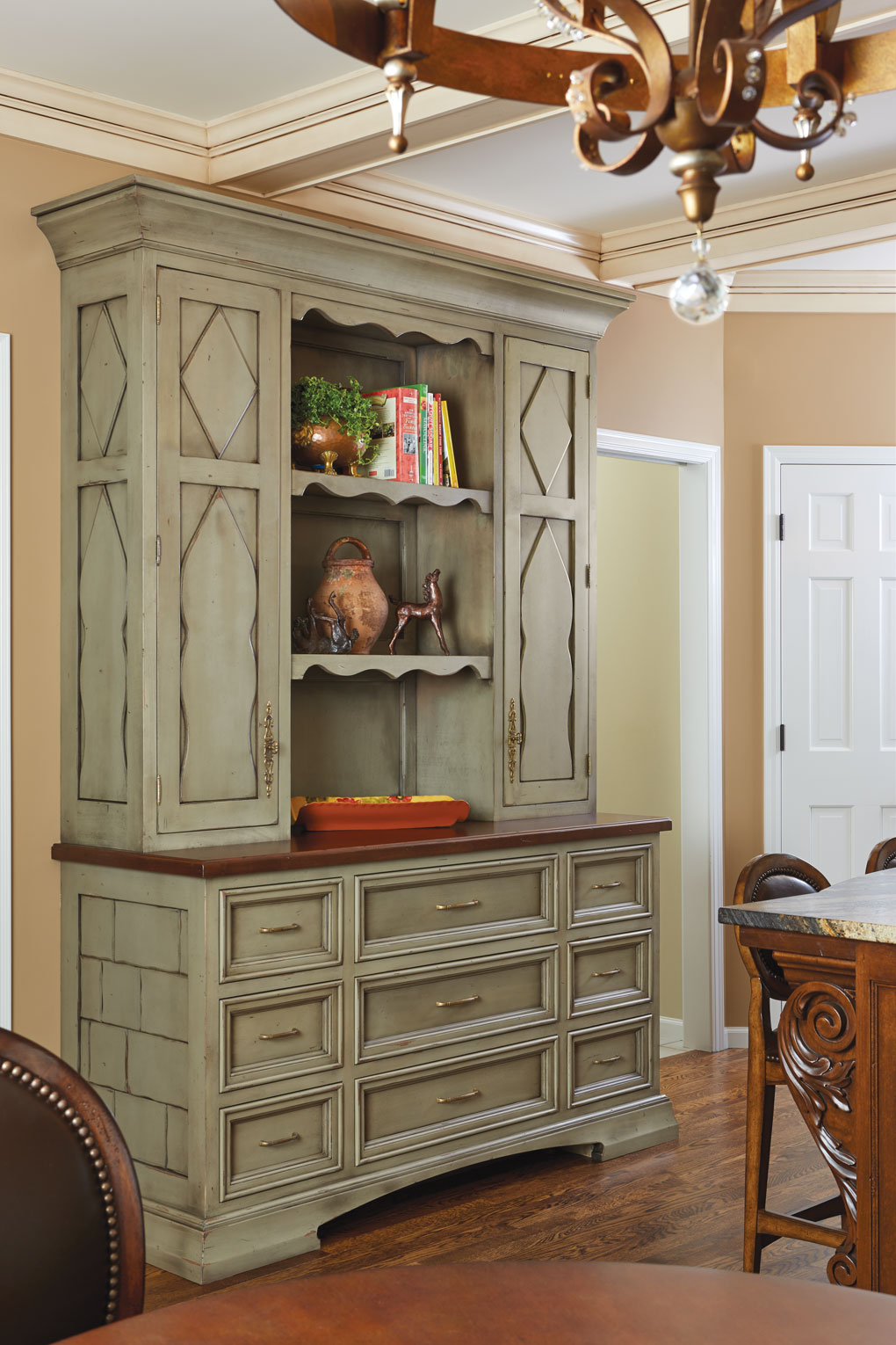 A stand-alone cabinet plays the role of utility player in a kitchen.