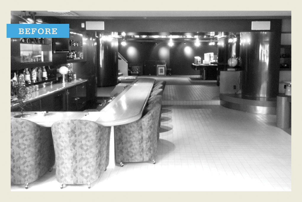 "A black and white ""before"" photo showing a bar with dance floor in the background."