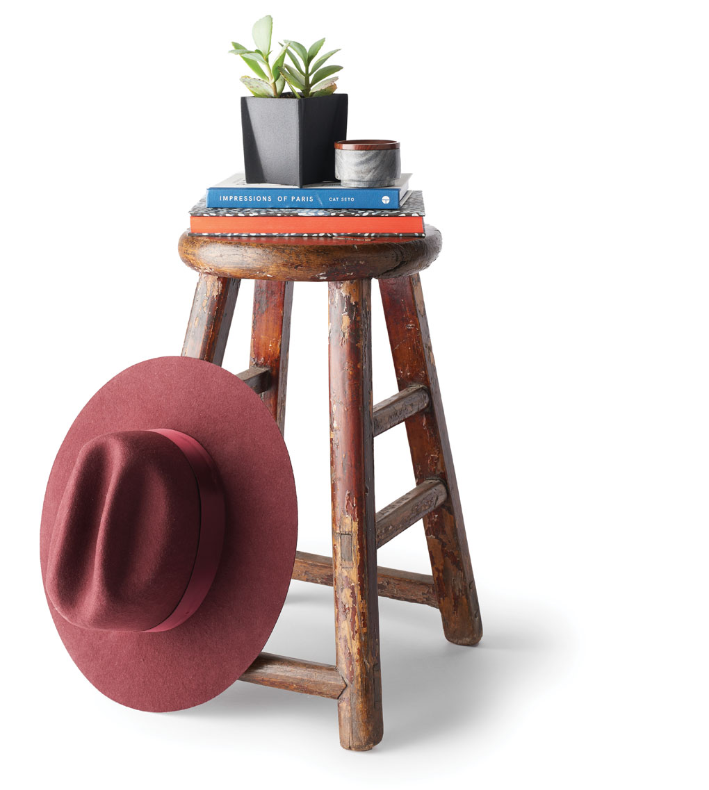 An antique round stool by HomeGoods.