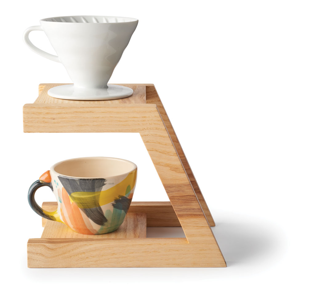 White Peach Pottery mugs are perched on top of a solid wood pour-over.