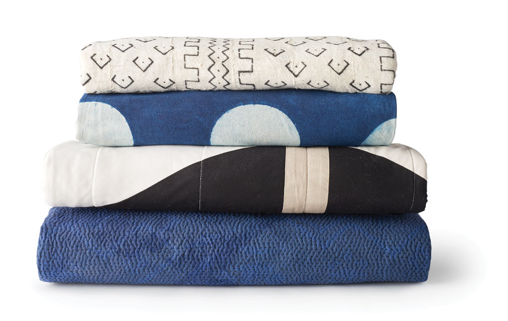 A stack of throw blankets by Ciel Loft & Home and The Golden Rule.