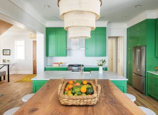 An all white kitchen with kelly green-colored cabinets.