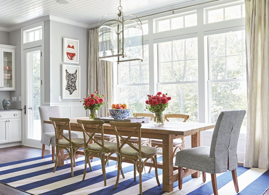 A dining area in a Lake Minnetonka home decorated with vintage swimwear.