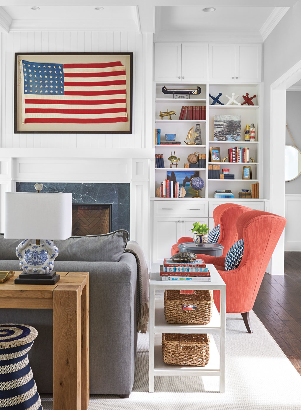 The centerpiece in this Lake Minnetonka home living room is a framed 48-star American flag over the fireplace.