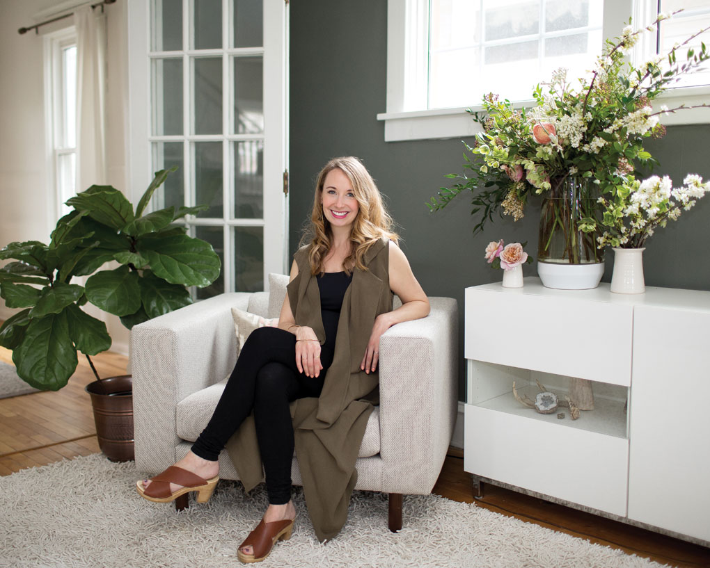 A portrait of Jackie Reisenauer, owner of Munster Rose, inside her home.