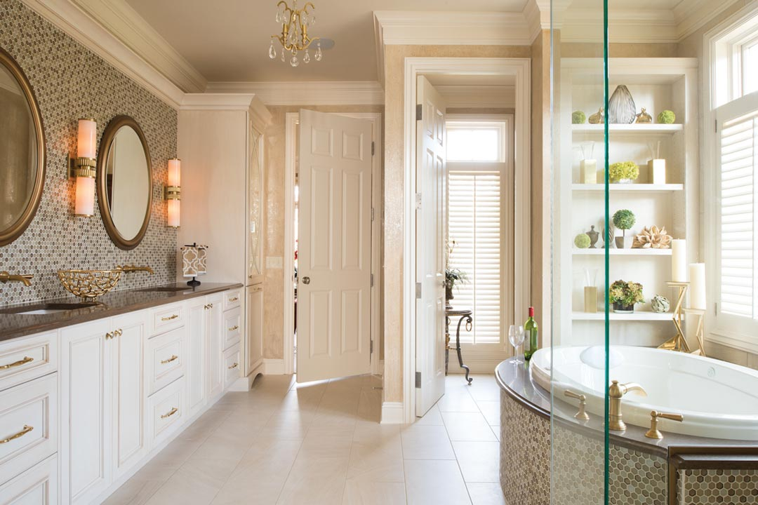 A bathroom featuring tile floor, large soaking tub, chandelier and shelves with green plant decor.