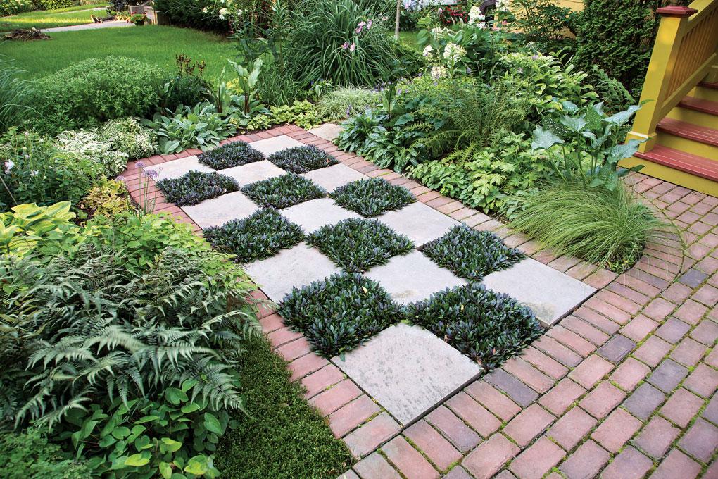 "A checkered walkway using stone and ajuga ""Chocolate Chip."""