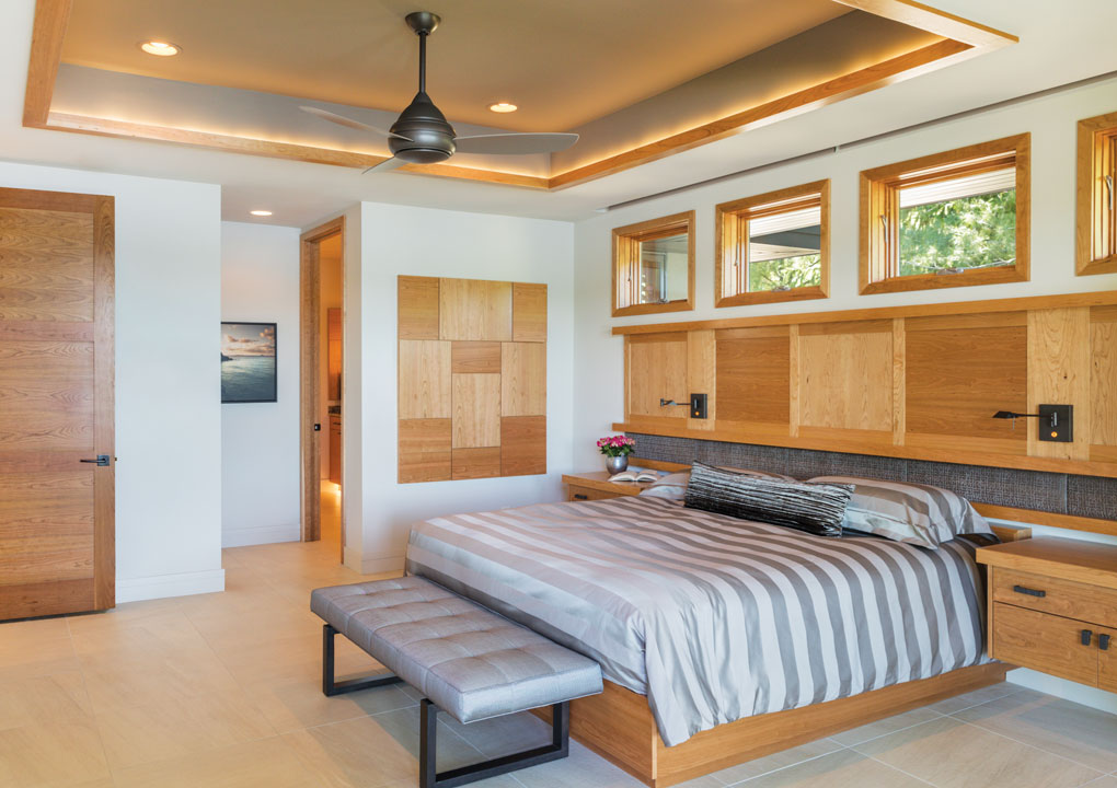 The main-level master suite features a built-in bed and night tables, as well as an art piece of the same rift-sawn cherry.