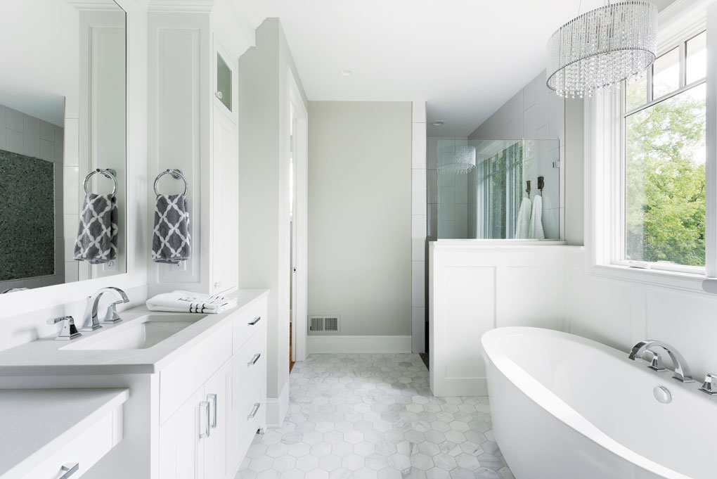 A master bath features a Roman shower, freestanding tub, and his-and-hers vanities.