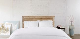 A master bed outfitted with white linens from SOL Organics.