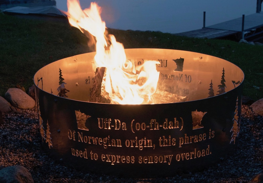 A customized fire pit ring with the definition of Off-Da, trees and the state of Minnesota carved into it.