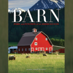 "The front cover of a book featuring a red barn in a field with mountains in the background. The book is ""Barn: Form and Function of an American Icon"""