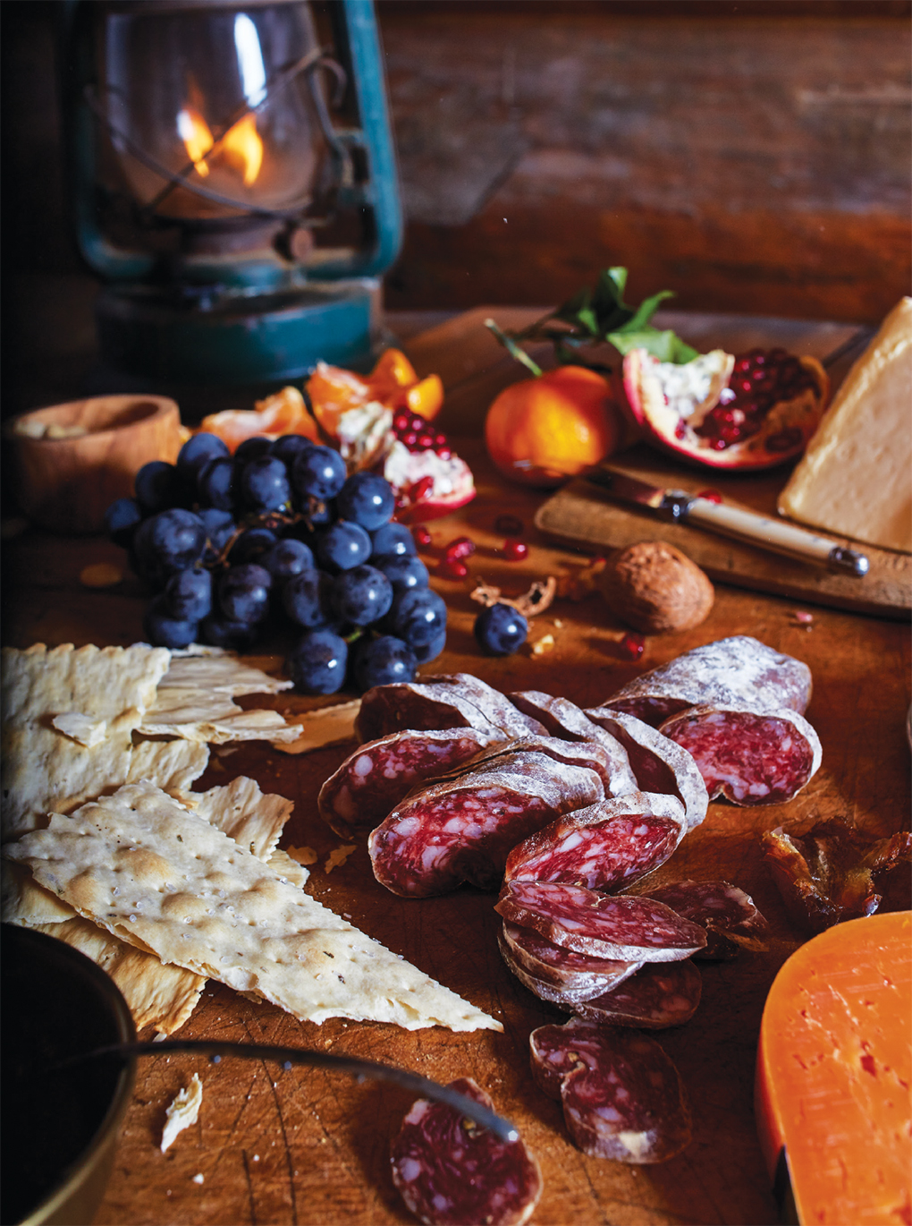 Cheese board with meats, fruit and cheese
