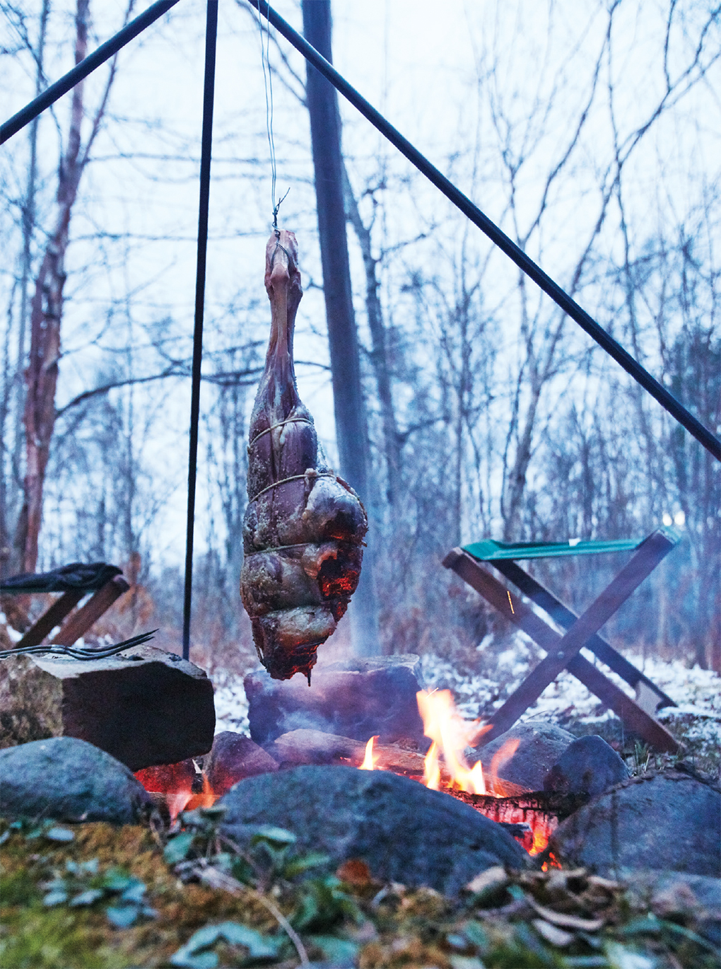 Leg of lamb suspended over fire