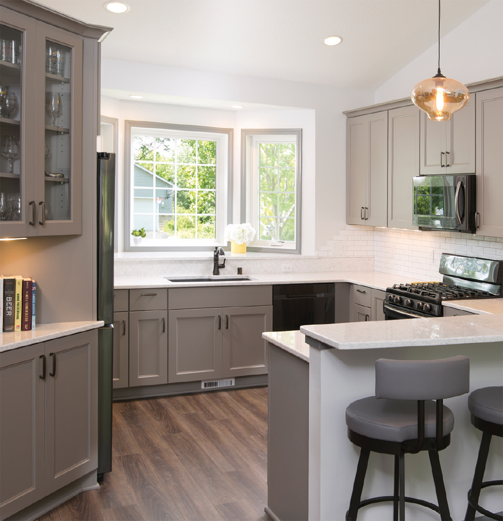 Grey and white kitchen with white countertops and grey accent furniture
