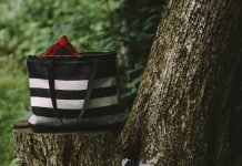 Patterned totes by Faribault Woolen Mill sitting on a tree stump.