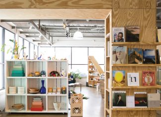 Inside Forage Modern Workshop shows shelves stocked with products, including, bowls, books and other home decor.