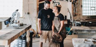 Anna and Nathanael Bailey of Bailey Builds in their shop with their dog, Oakley.