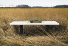 A table from Gather Table Co. standing in a field.