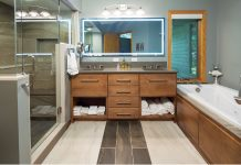 A large bathroom with glass shower and soaking tub built by Novare Renovation & Design.