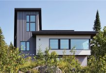 The exterior of a modern home with large windows built by SALA Architects.