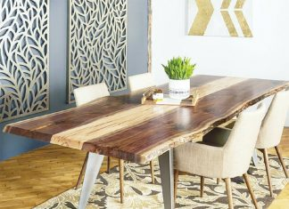 A wood table surrounded by chairs by Timber & Tulip.