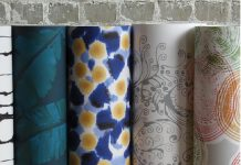 A collection of rolled up wallpaper on display.