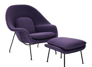 A purple chair and footstool.