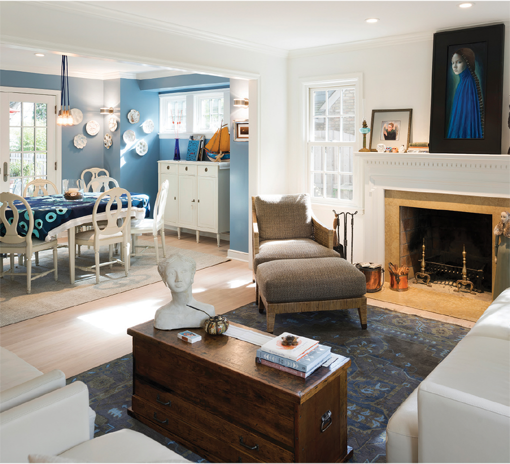 The moody blue accents of the living room take on fresher hues in the dining room.