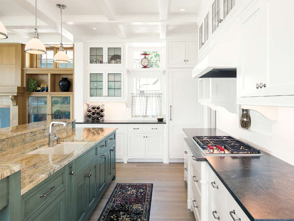 To avoid blocking the lake view, the kitchen holds only essential appliances camoflauged behind cabinetry. The rest are housed in the adjacent pantry.