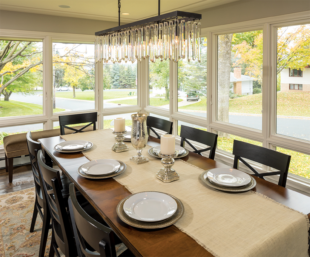 The remodel transformed a once-gloomy porch into this window-wrapped dining room.