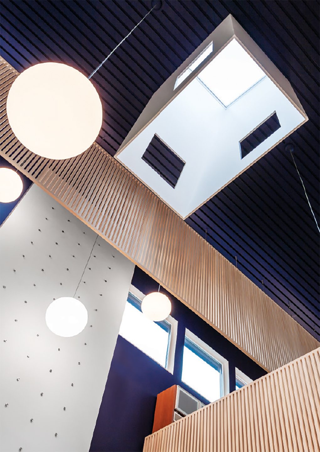 The holes punched in the skyboxes create a play of light and shadow throughout the day.