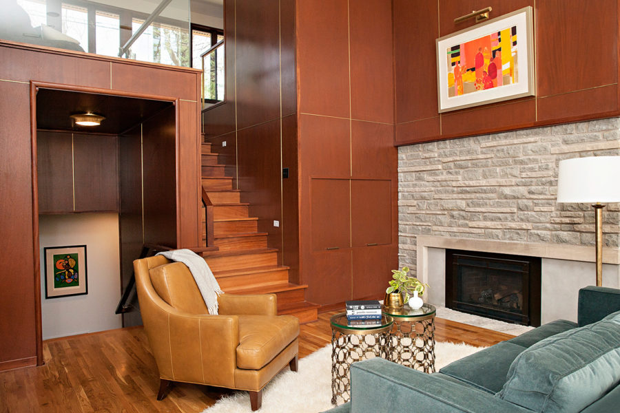 Photo of renovated living room with fireplace by Bella Custom Homes.