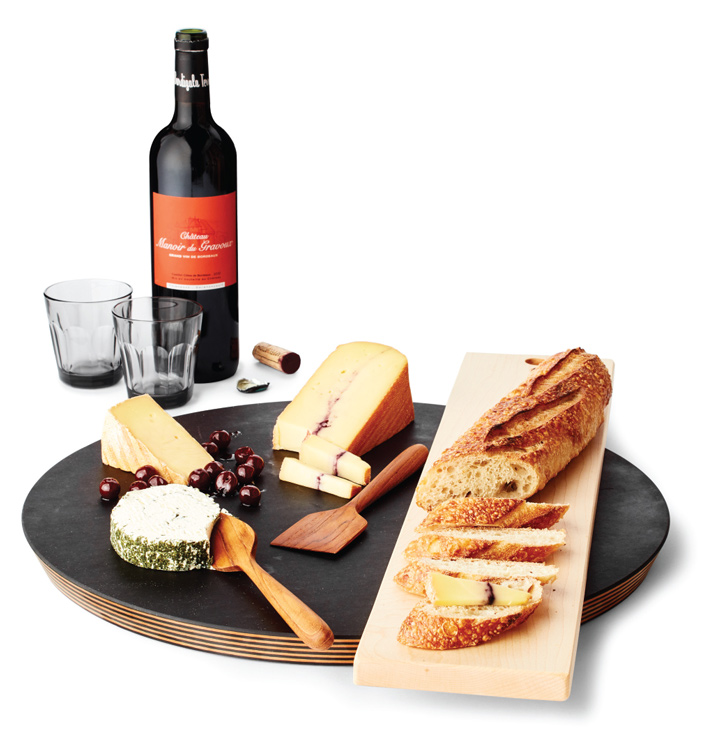 A cheese platter with accompanying wine.